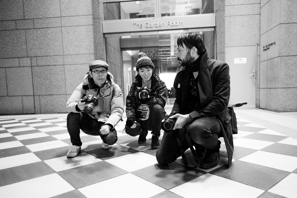 Laurence and his pupils learning how to use patterns and contrast in street photography at Ebisu Garden Place.