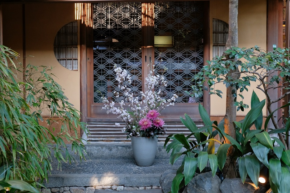 Kyoto's Finest: Cherry Blossom Season - EYExplore - This ikebana flower arrangement in front of someone's house incorporates cherry tree branches. You can find lots of interesting things just taking a walk with your camera.