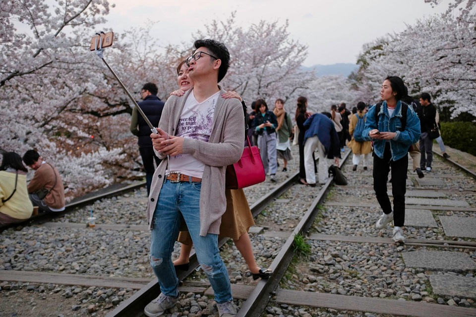 Kyoto's Finest: Cherry Blossom Season - EYExplore - Taking selfies along the tracks at Keage Incline.