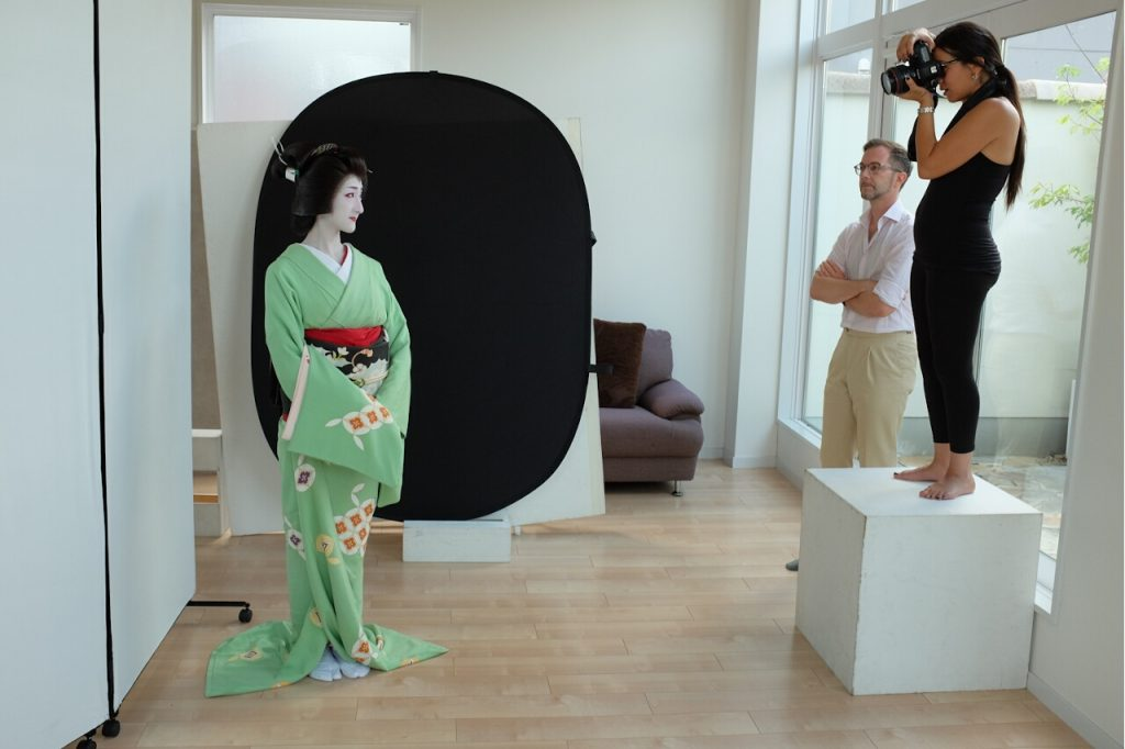 Behind The Mask Geisha Pro Photo Shoot-Safaa stands on a wooden box to get a little more height.