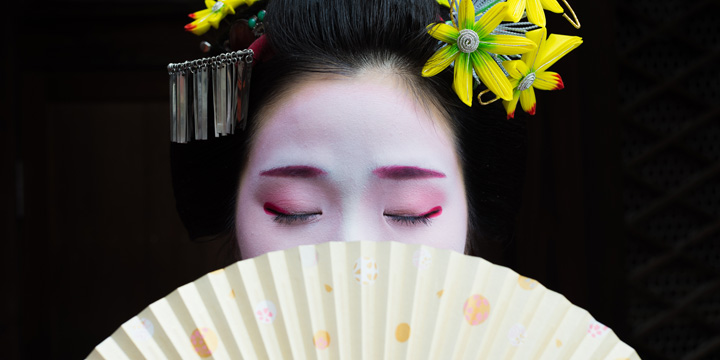 A geisha calmly sits with her eyes closed for a candid shot during the photography workshop in Kyoto