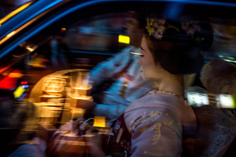 Geisha speeding off into the night in Gion, Kyoto - EYExplore