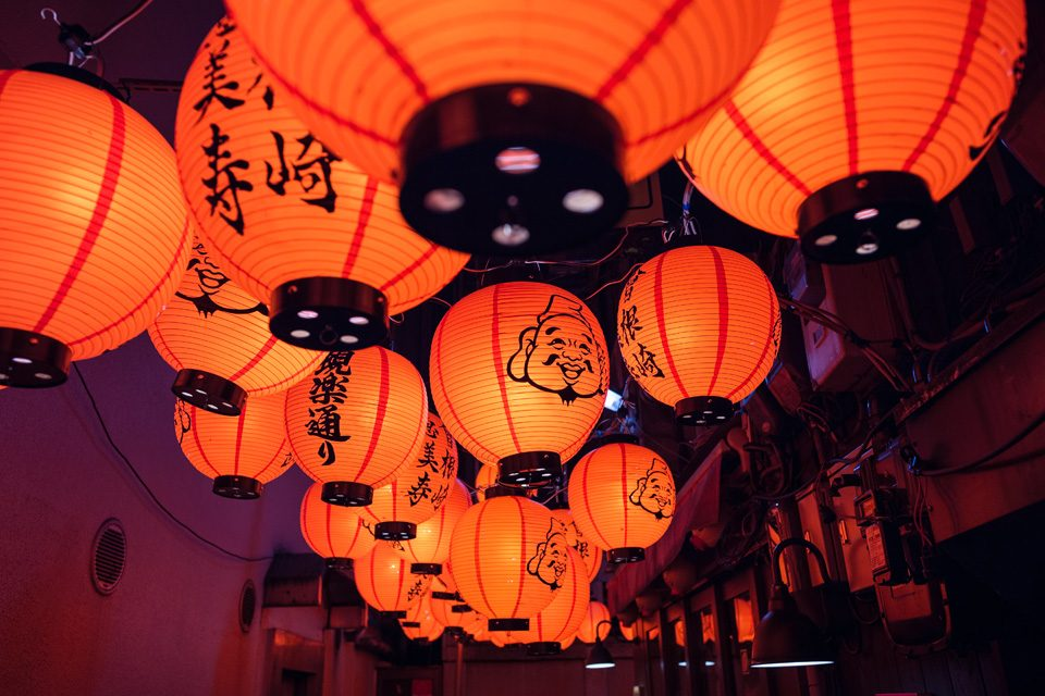 Lamps in Osaka adorned with Ebisu, a lucky god - EYExplore