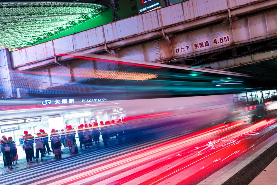 Traffic rushing past Umeda station in Osaka - EYExplore