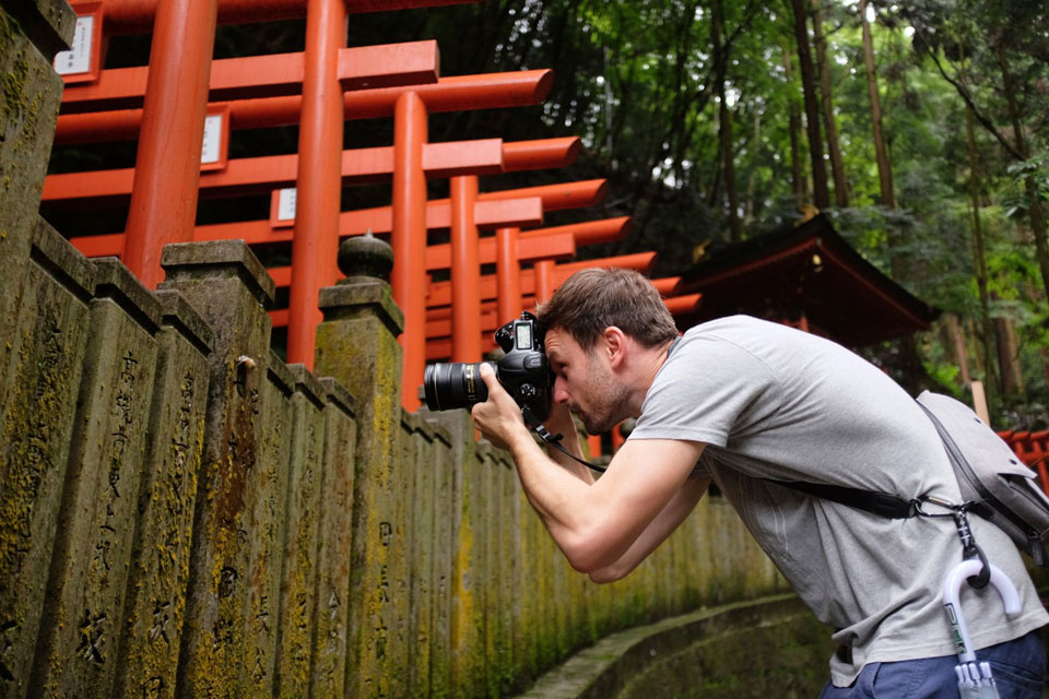 Lukasz (that's me) photographing a snail at Tanukidani Temple.