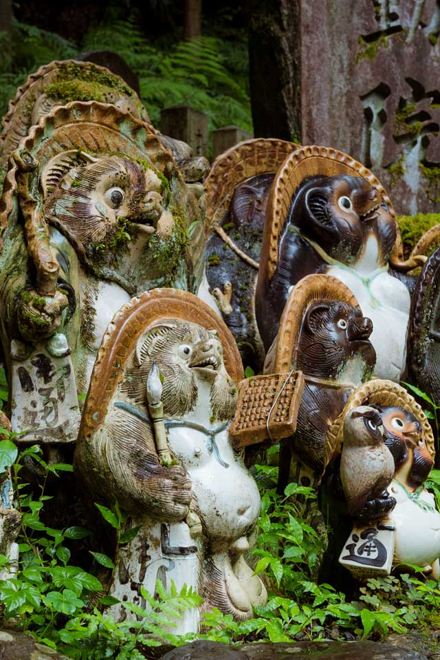 Some of the many statues at Tanukidani.