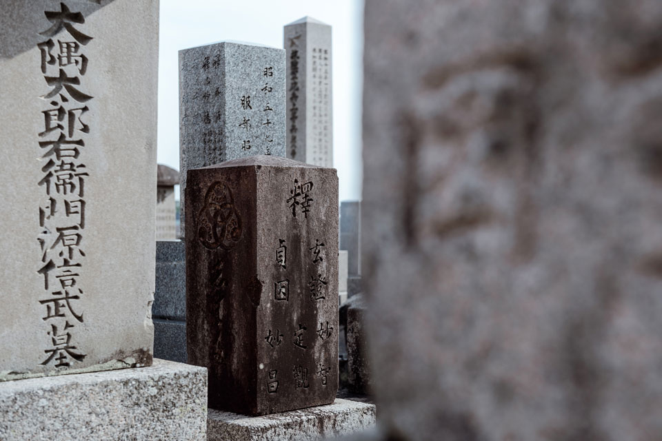 Using a long lens, we can create a mosaic of forms, shapes, and textures amidst the gravestones in Toribeno Cemetery. Shot at 58mm on a full frame camera.